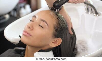 Woman Washing Hair at the Barber Shop
