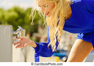 Woman washing hands outdoor
