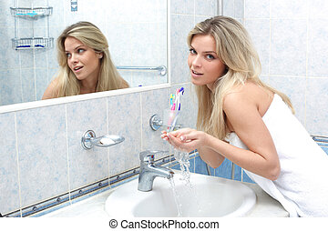 woman washing in the bathroom