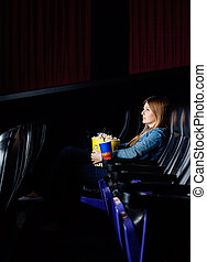 Woman Watching Movie At Cinema Theater