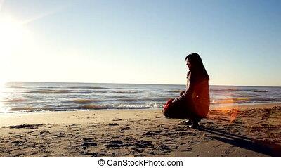 woman watching sunset sitting