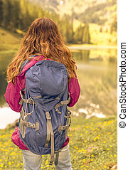 Woman watching the lake view during a hiking trip