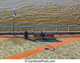 Woman Watching the River in the Boardwalk of Rosario City