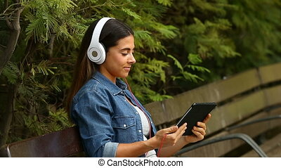 Woman watching videos in a park