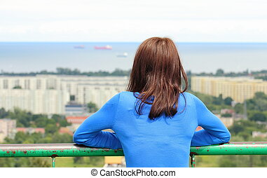 Woman watching view of the city Gdansk