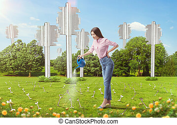 Woman watering keys sticking out of the ground