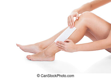 Woman Waxing Her Legs
