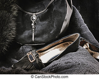 woman wear accessories: fashionable handbag and shoes at fur