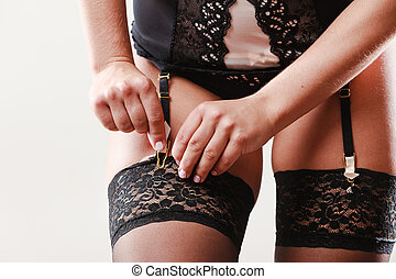 Woman wear garter belt and stockings.