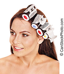 Woman wear hair curlers on head. - Happy beautiful woman...