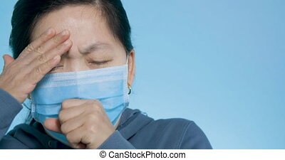 woman wear mask having cold and coughing