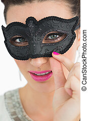 Woman wearing a black mask