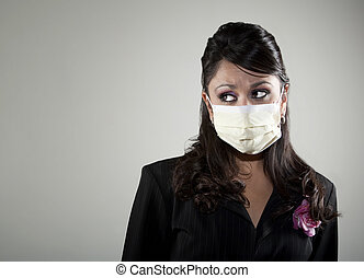 Pretty young woman wearing a breathing mask for protection from germs and viruses