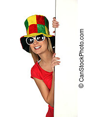Woman wearing a comical hat and sunglasses