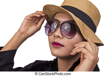 Woman wearing a hat with sunglasses.
