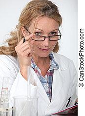 Woman wearing a lab coat