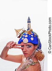 Woman wearing a nautical themed hea