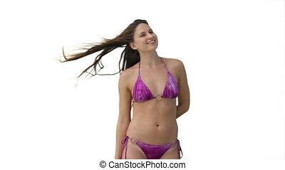 Woman wearing a purple bikini moves around