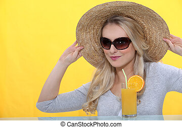 Woman wearing a straw hat