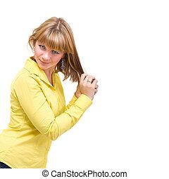 woman wearing a yellow shirt posing