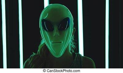 Woman wearing an alien mask - Portrait of caucasian blonde...