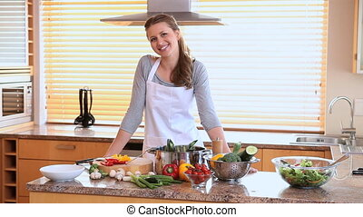 Woman wearing an apron in her kitchen