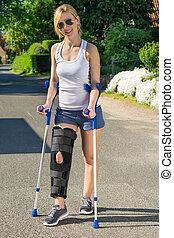 Woman wearing an orthopaedic leg brace with adjustable...