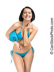 Woman wearing bikini and handing towel