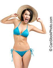 Woman wearing bikini  and straw hat