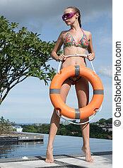 woman wearing bikini at the swimming pool