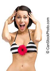 Woman wearing bikini with red flower