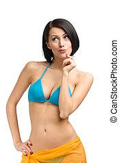 Woman wearing bikini with yellow pareo