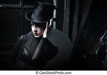 Woman wearing black topper