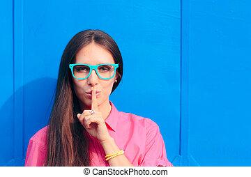 Secretive girl asking for silence not spreading rumors and gossip