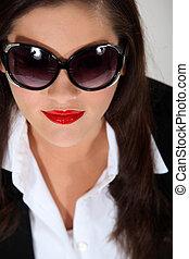 Woman wearing bug-eye sunglasses