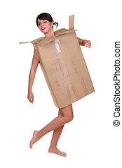 Woman wearing cardboard box