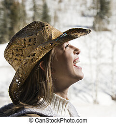 Woman wearing cowboy hat.
