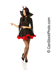 Woman wearing devil clothes pointing left