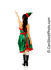 Woman wearing elf clothes pointing up