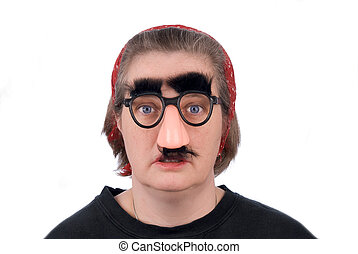 Woman wearing fake nose and glasses with mustashe and eyebrows over awhite background