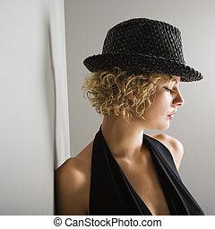 Woman wearing fedora.
