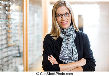 Woman Wearing Glasses With Arms Crossed In Store