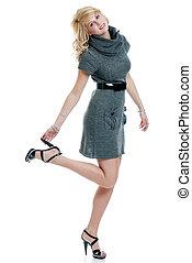 woman wearing grey knit dress