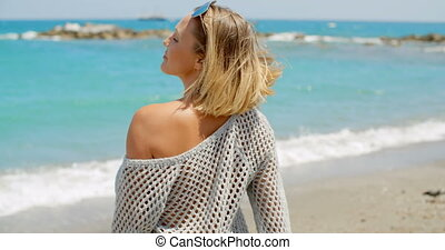 Woman Wearing Grey Sweater on Beach with Open Arms - Smiling...