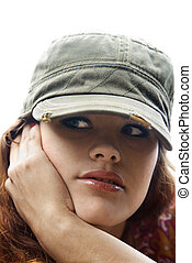 Woman wearing hat.