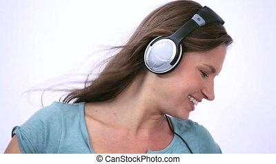 Woman wearing headphone while danci - Video of a woman...