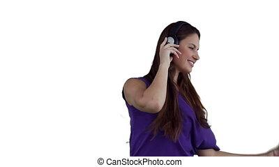 Woman wearing headphones as she dances