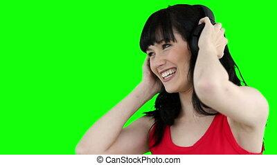 Woman wearing headphones while dancing