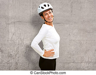 Woman wearing helmet with hand on hip