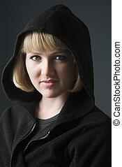 Woman wearing hoodie.